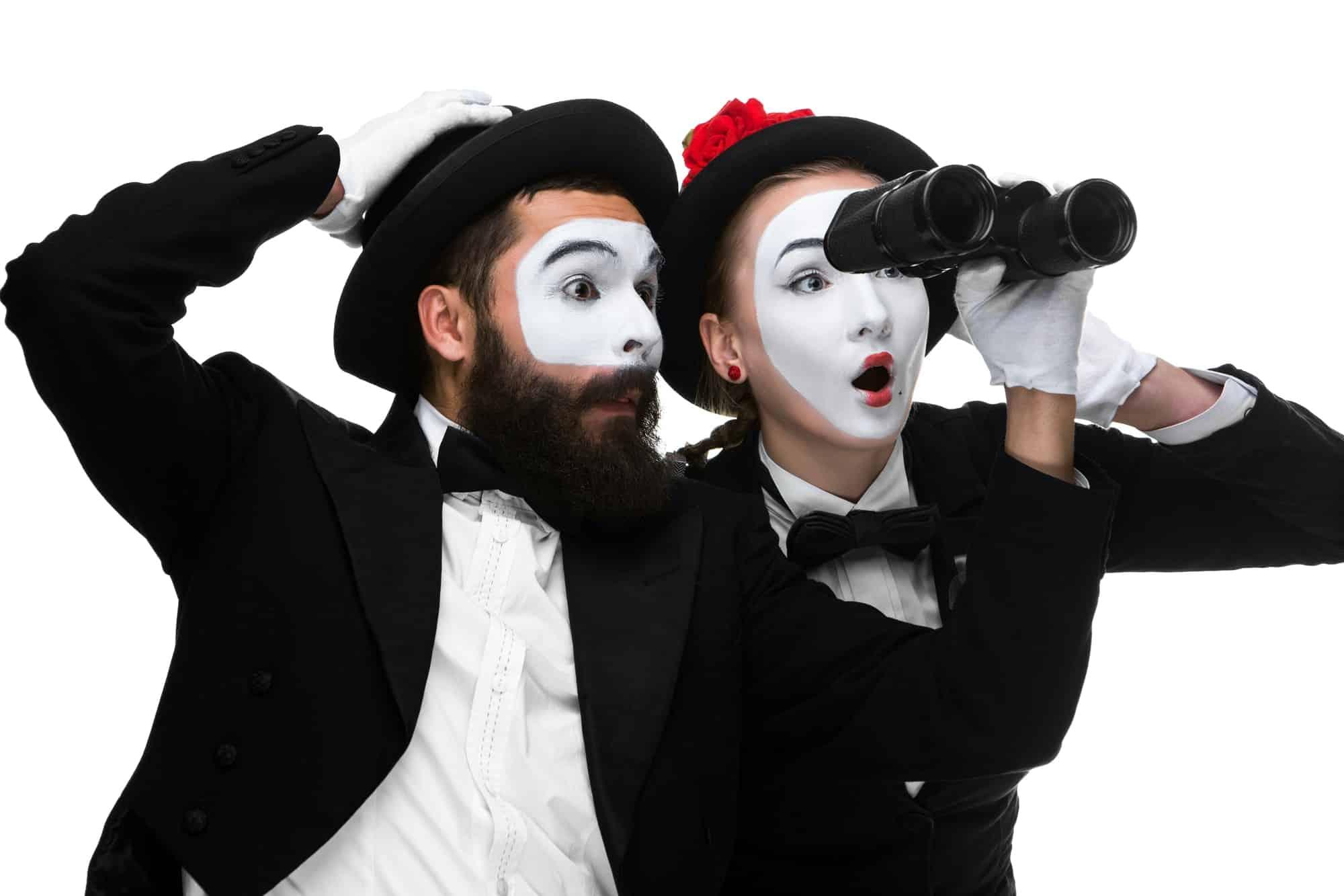 Two memes as business people looking through binoculars