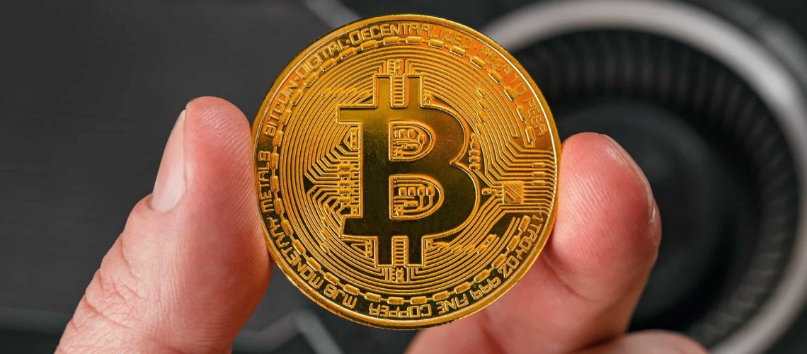 Closeup Of Hand Holding Bitcoin Crypto Currency Coin